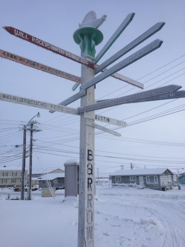 Barrow, Alaska is one town that UW law students visited to help residents with their taxes. A local sign shows that Barrow is many miles from anywhere.