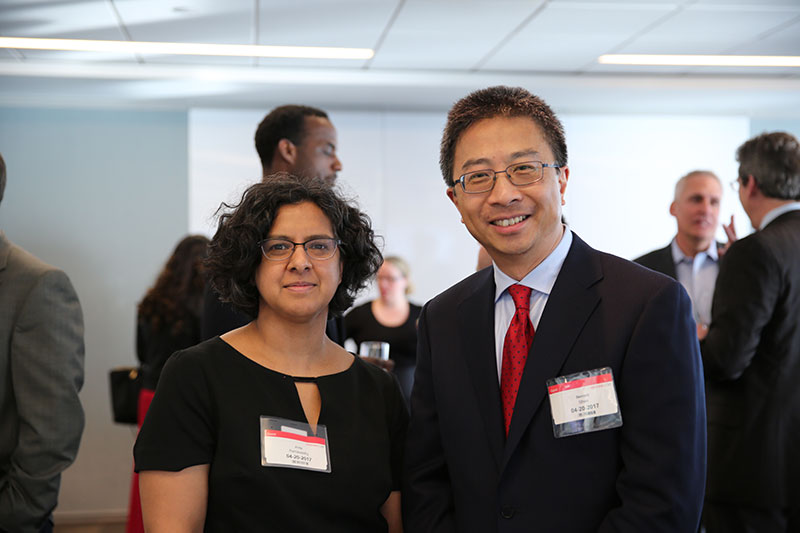 Professor Anita Ramasastry (left) talks with Bernard Shen, Assistant General Counsel at Microsoft (right)