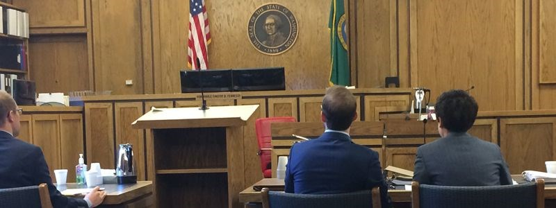 IPNW Student Che Schirmer and Staff Attorney Lauren McLane confer before a Spokane Superior Court motion hearing.