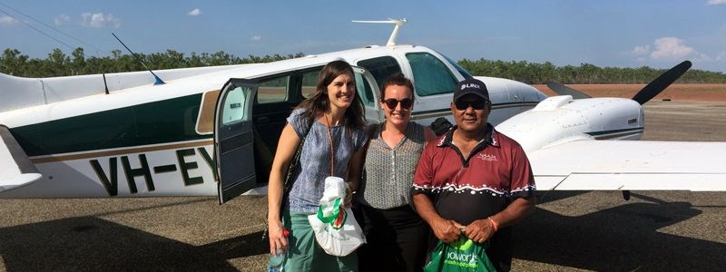 Frances Bain, left, flies to a remote community court that sits 1 day 4 times a year with a fellow criminal lawyer and client service officer.